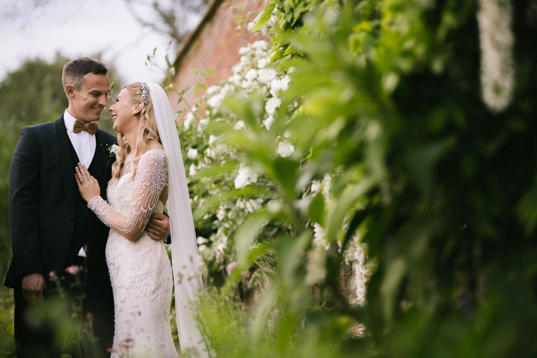 Recommended wedding photographer Stunning wedding portrait in the walled gardens at Delapre abbey
