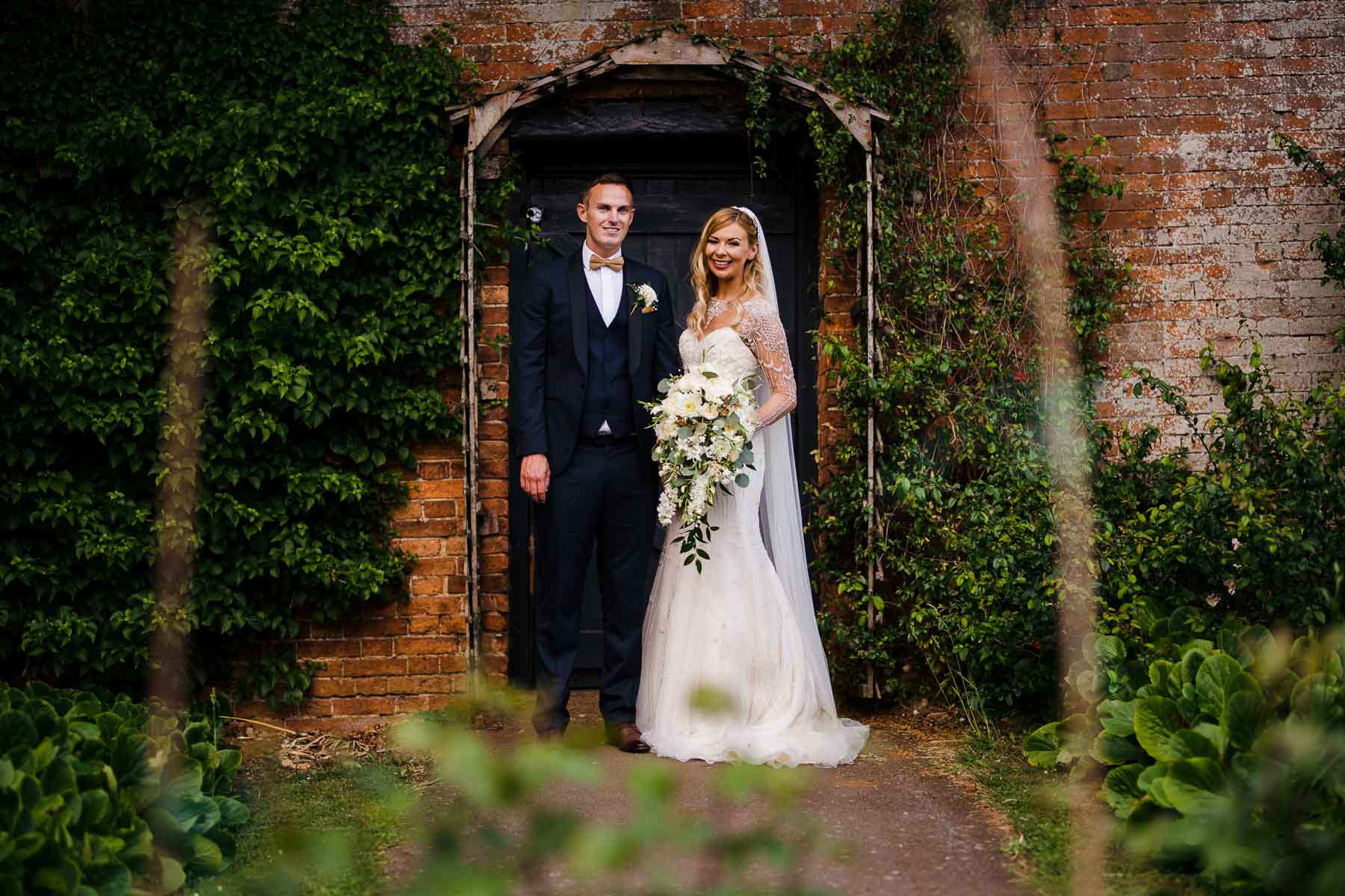 Bride and groom portraits in the walled gardens at Delapre Abbey
