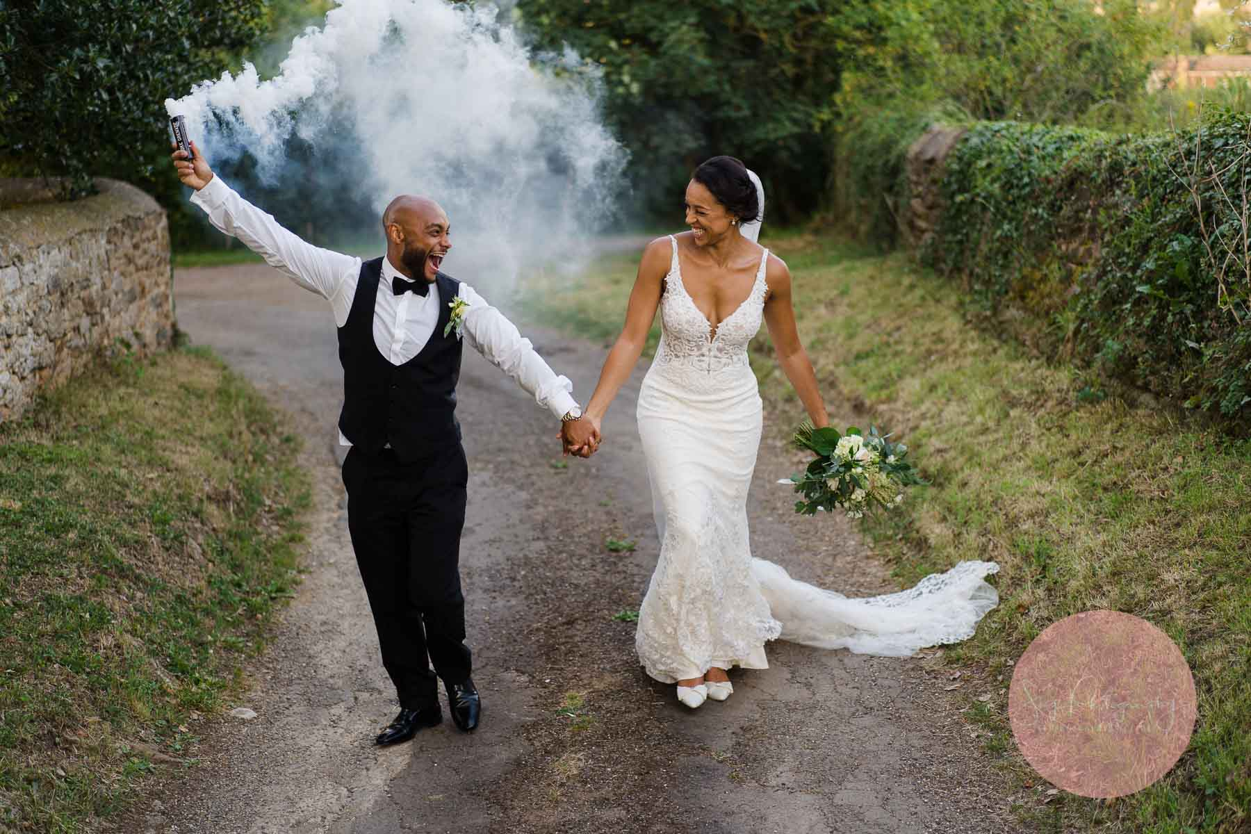 bride and groom using a smoke grenade at Dodford manor