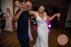 bride dancing with guests
