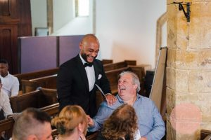 groom meeting guests at dodford church