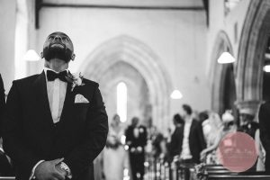 Emotional groom waiting for his