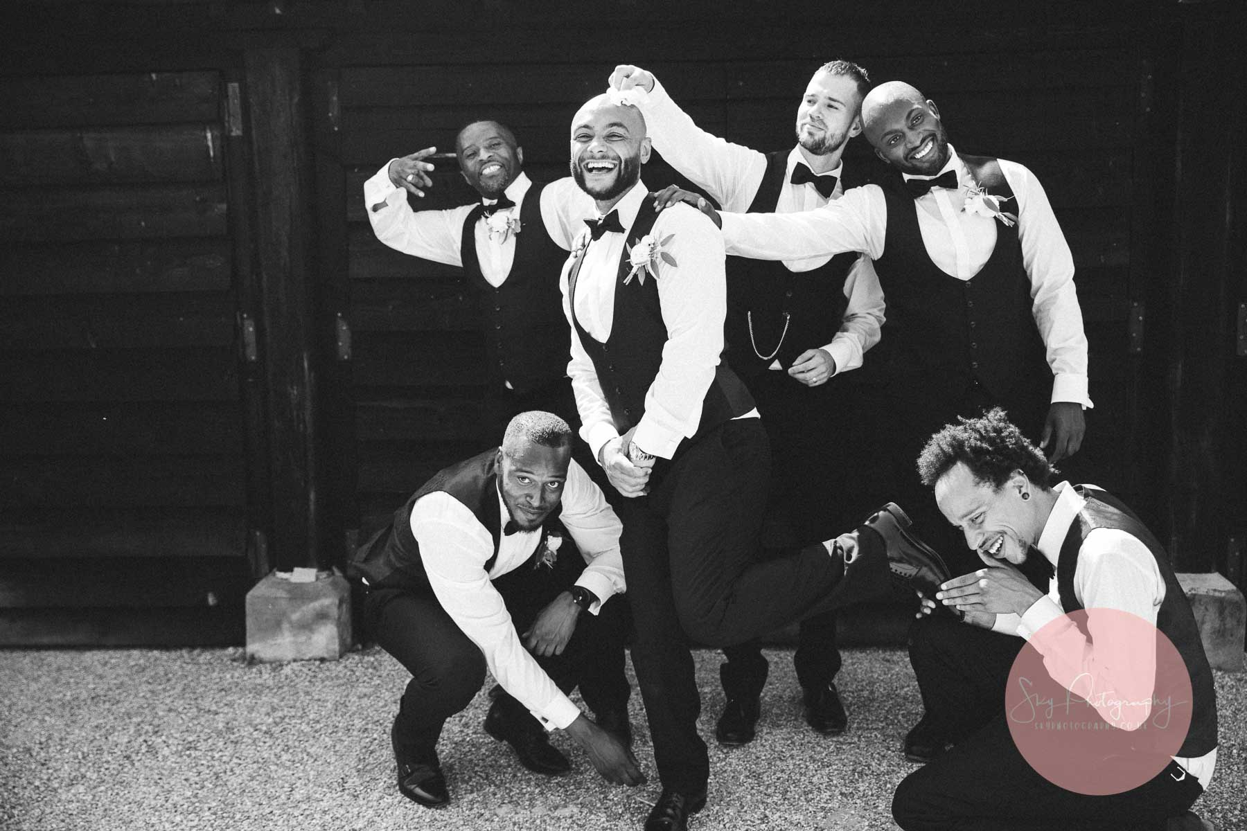 groomsmen play with the groom