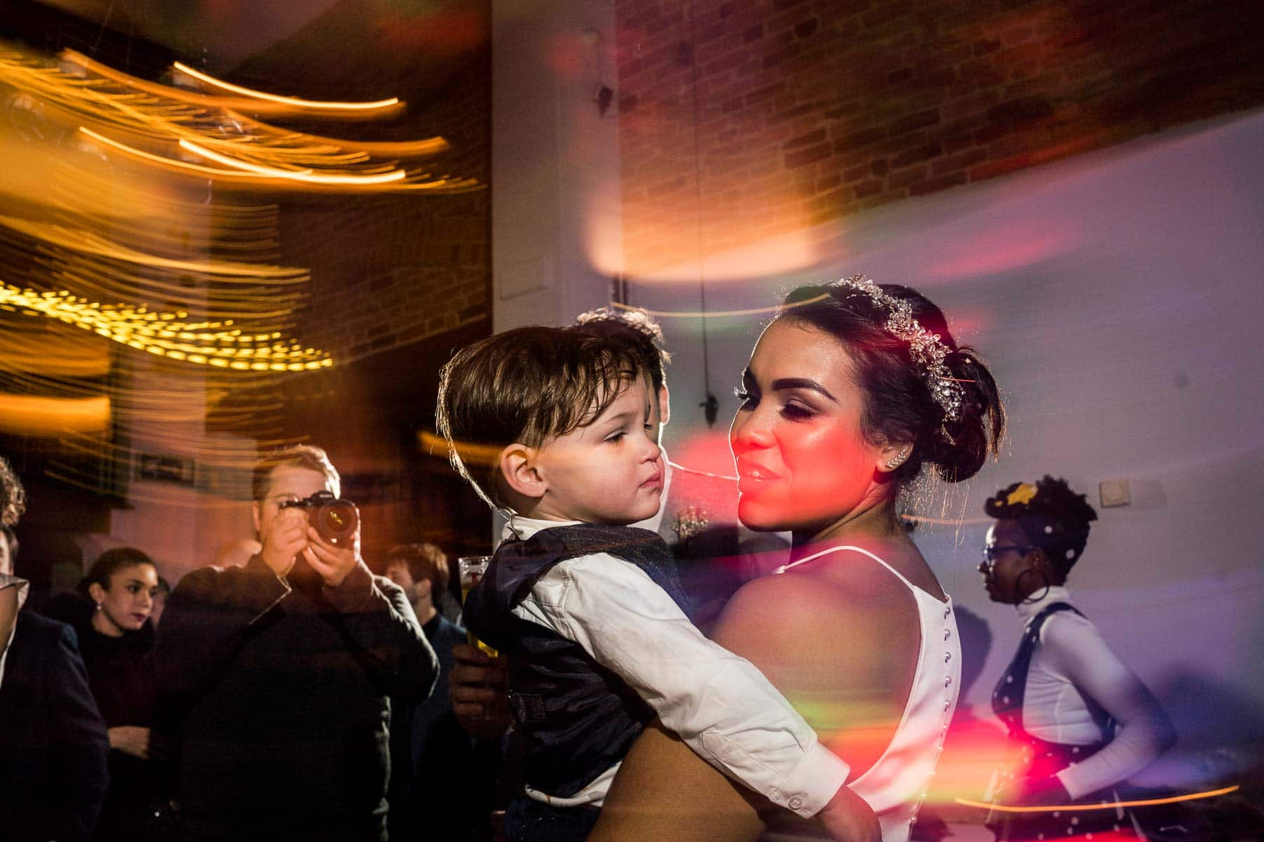 bride and son embrace on the dance floor