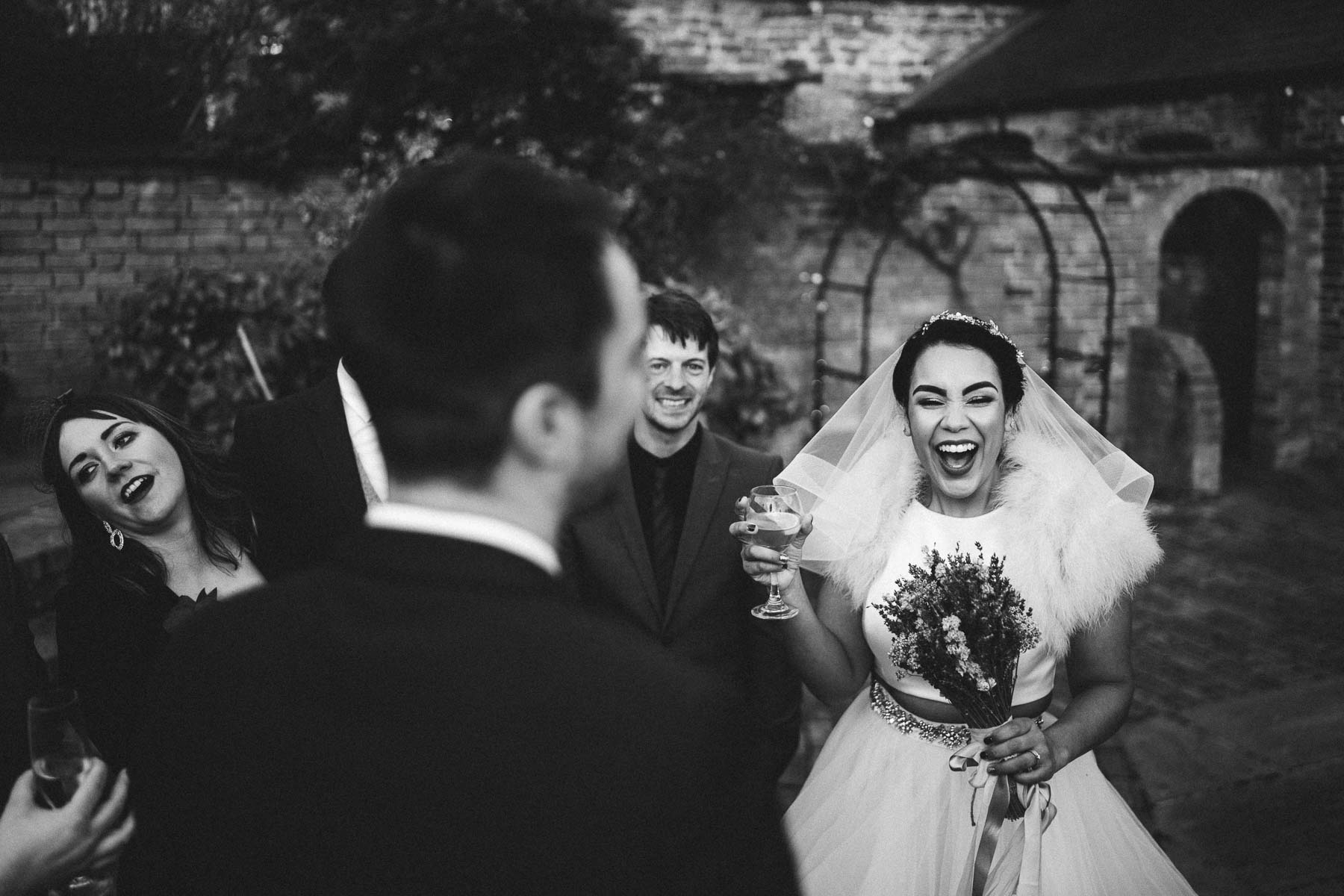 bride laughs at her guests jokes
