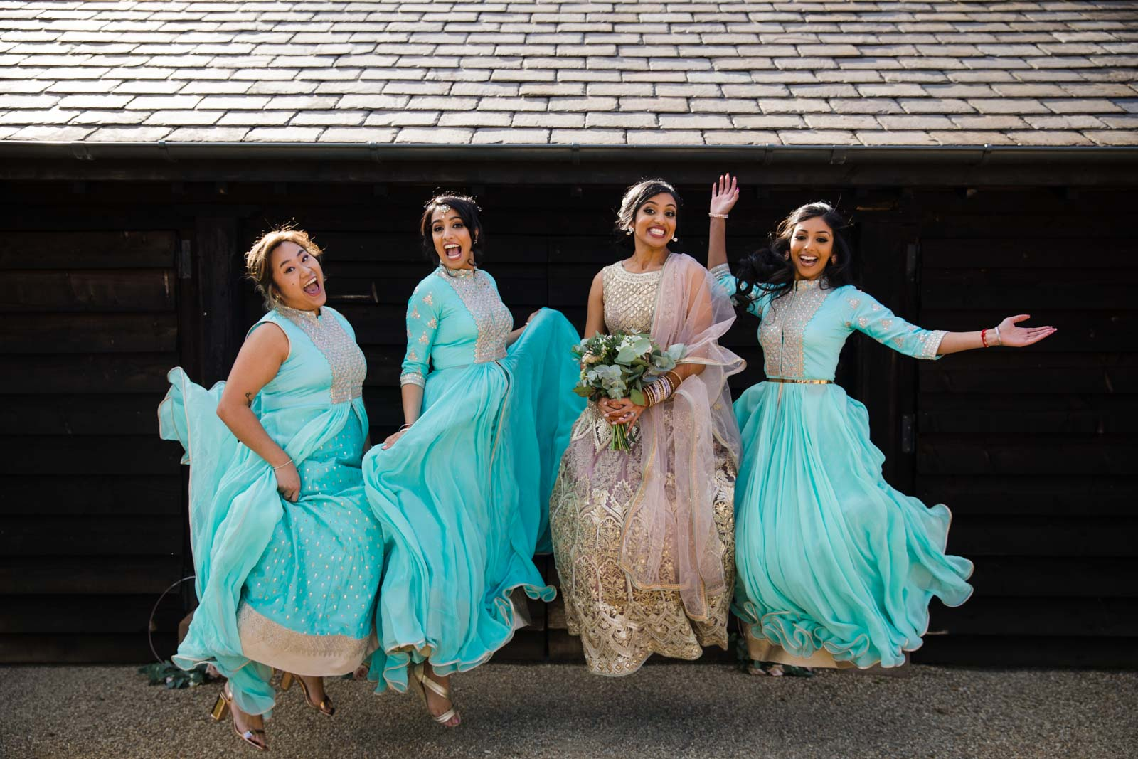 Bridesmaids jumping in the sun Wedding Photographer Warwickshire