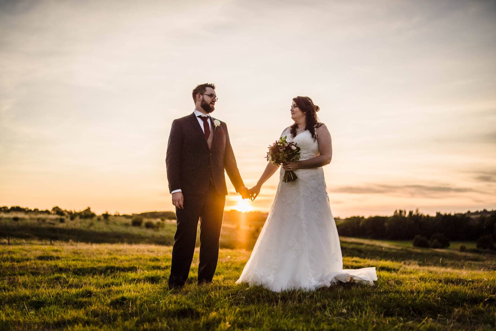 the sun between the couple by Wedding Photographer Cambridgeshire