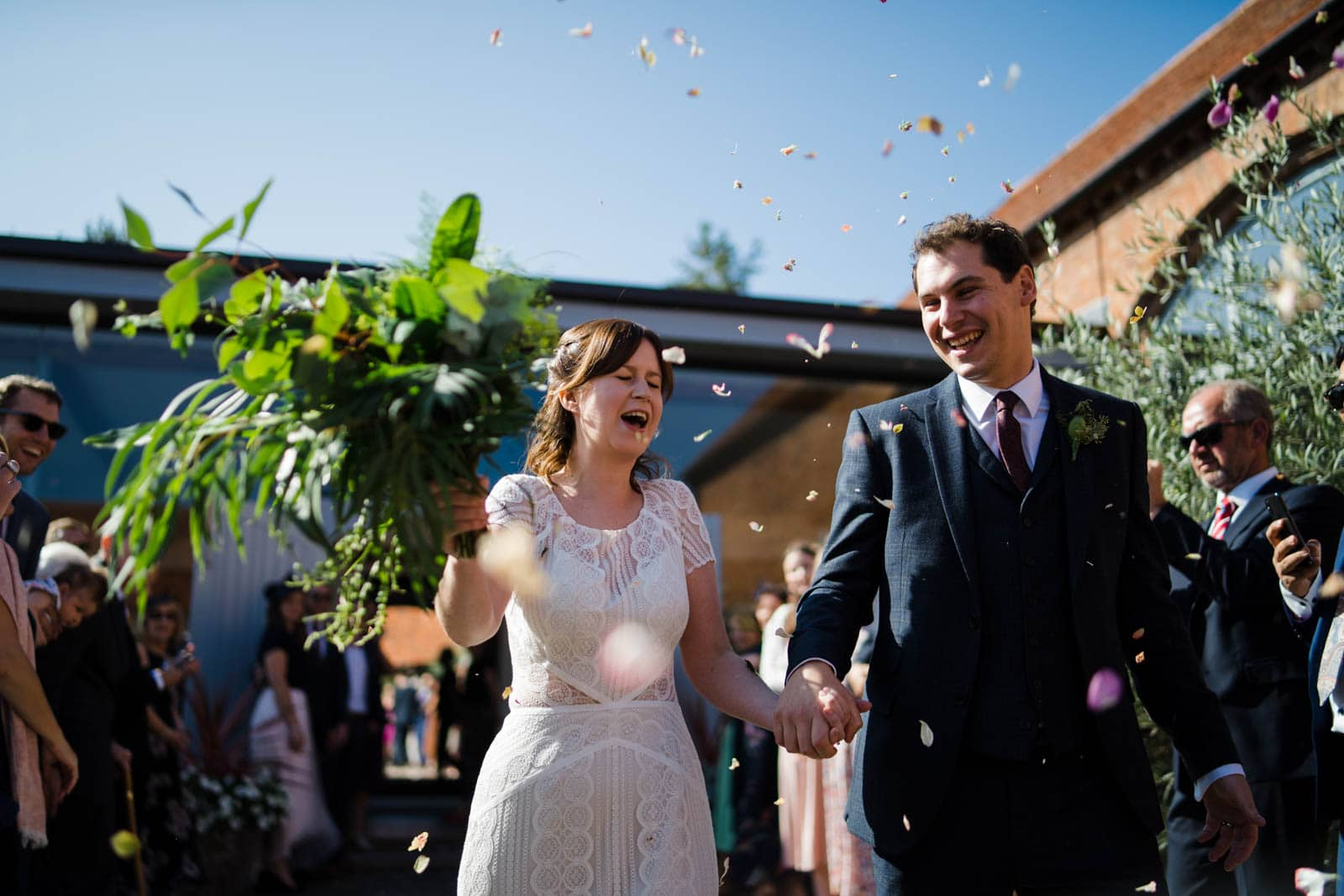 Bride and groom receiving confetti Wedding Photographer Warwickshire