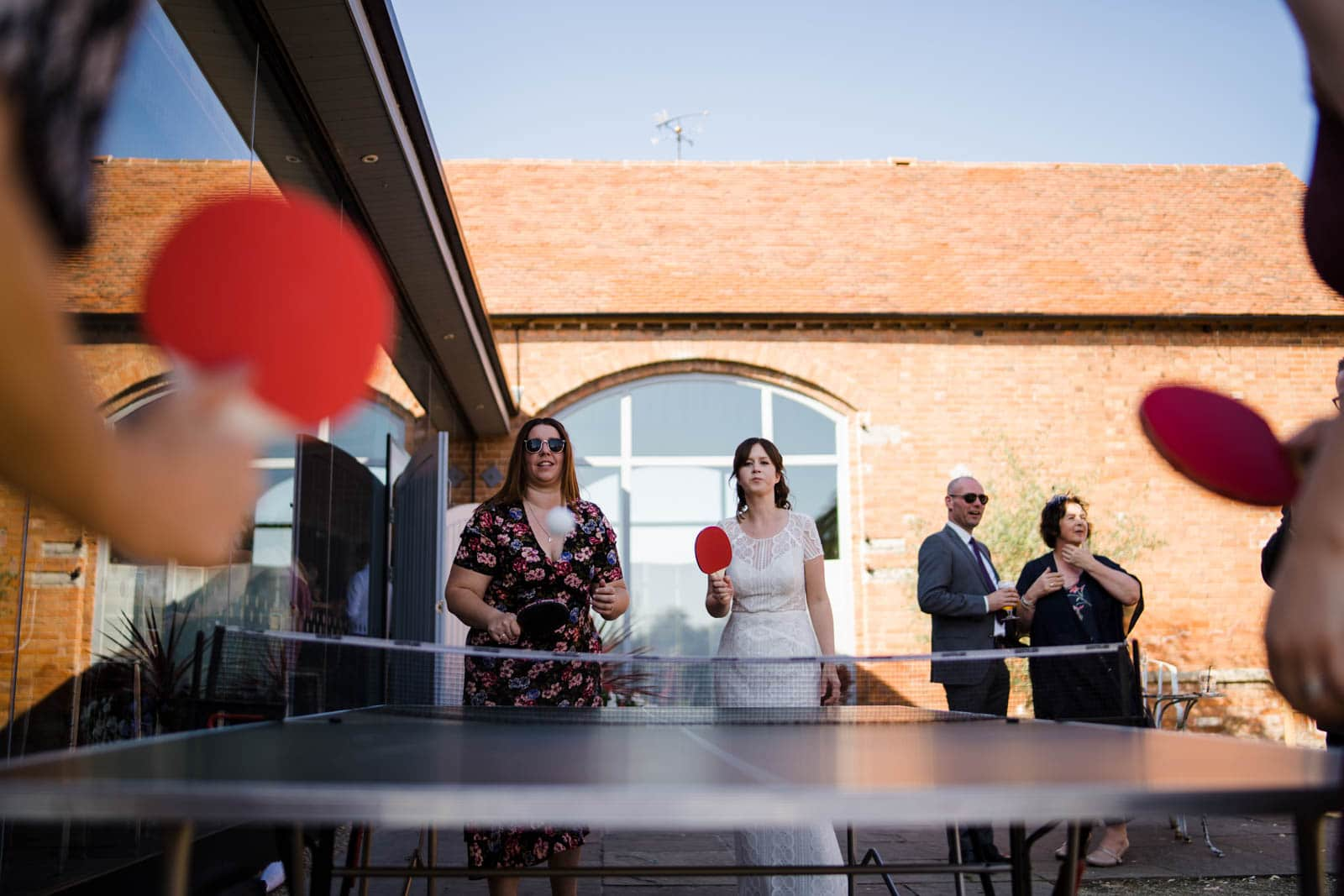 Wedding pingpong games at swallows nest barn