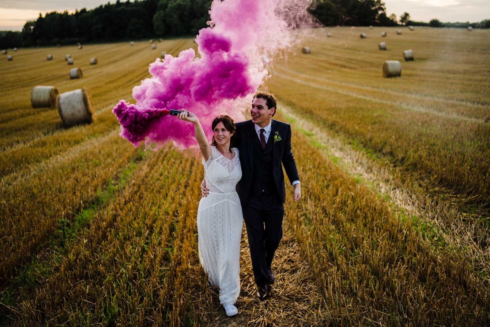 Swallows nest wedding wedding couple holding a pink flare