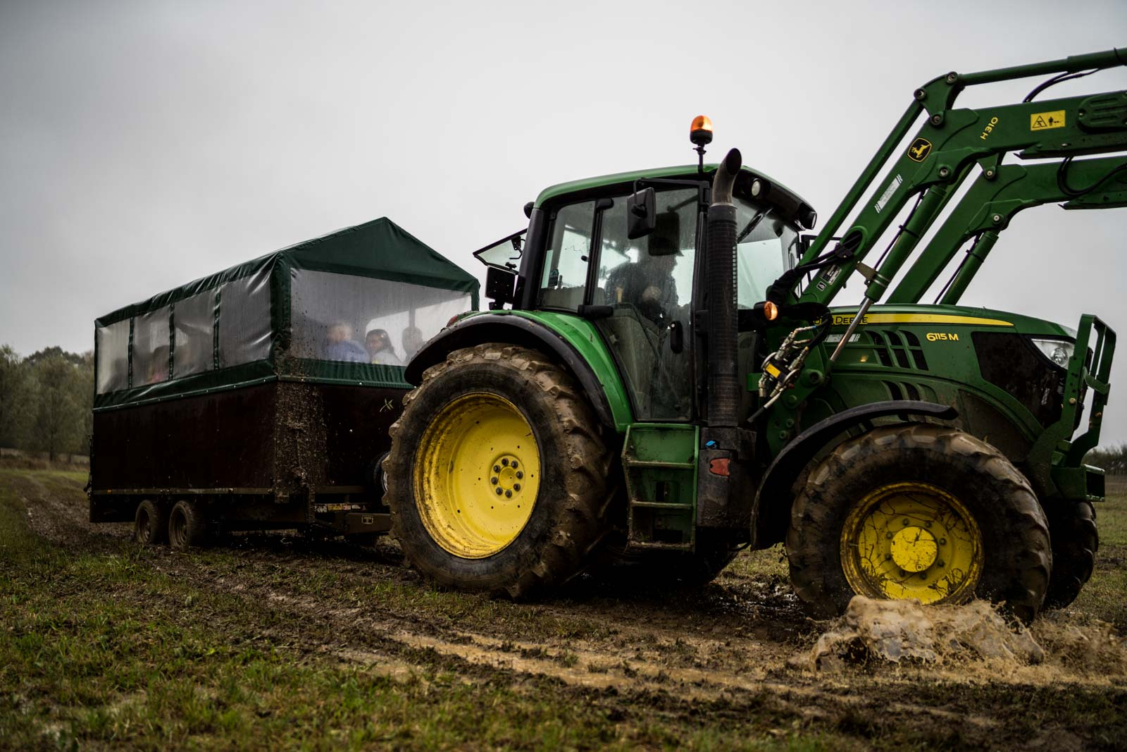 Farm Tractor transporting guests to a field wedding Wedding Photographer Cambridgeshire