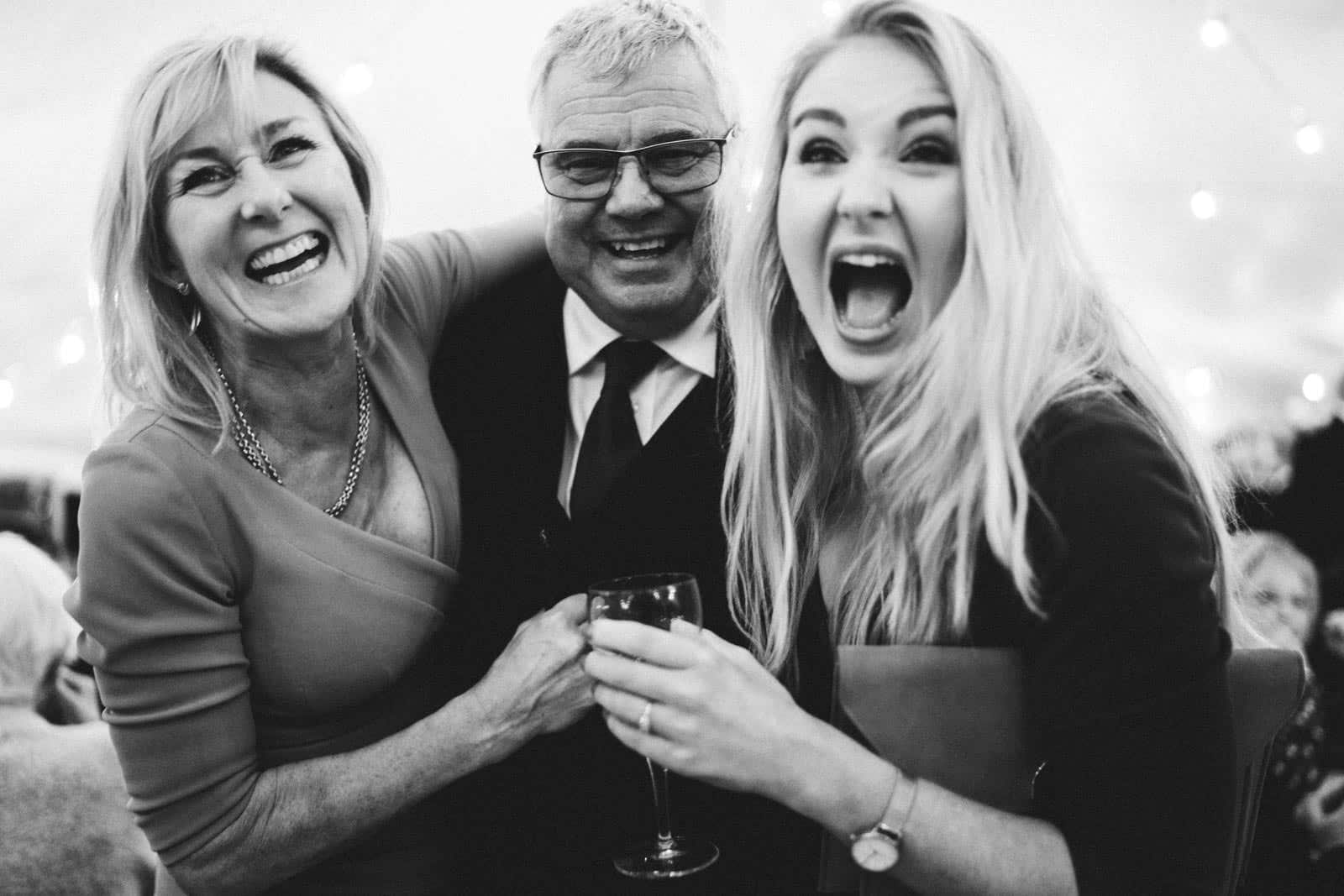 Guests laughing at a diy wedding in Wedding Photographer Cambridgeshire
