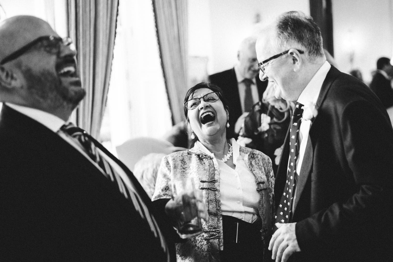 Wedding Guests laughing expressively at Kilworth House
