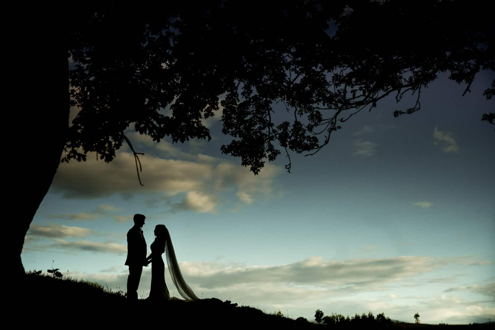 Stunning silhouette of a bride and groom at dodford manor
