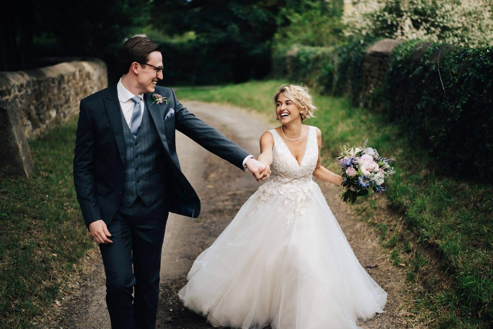 warwickshire wedding photographer, couple looking beautiful as they walk together