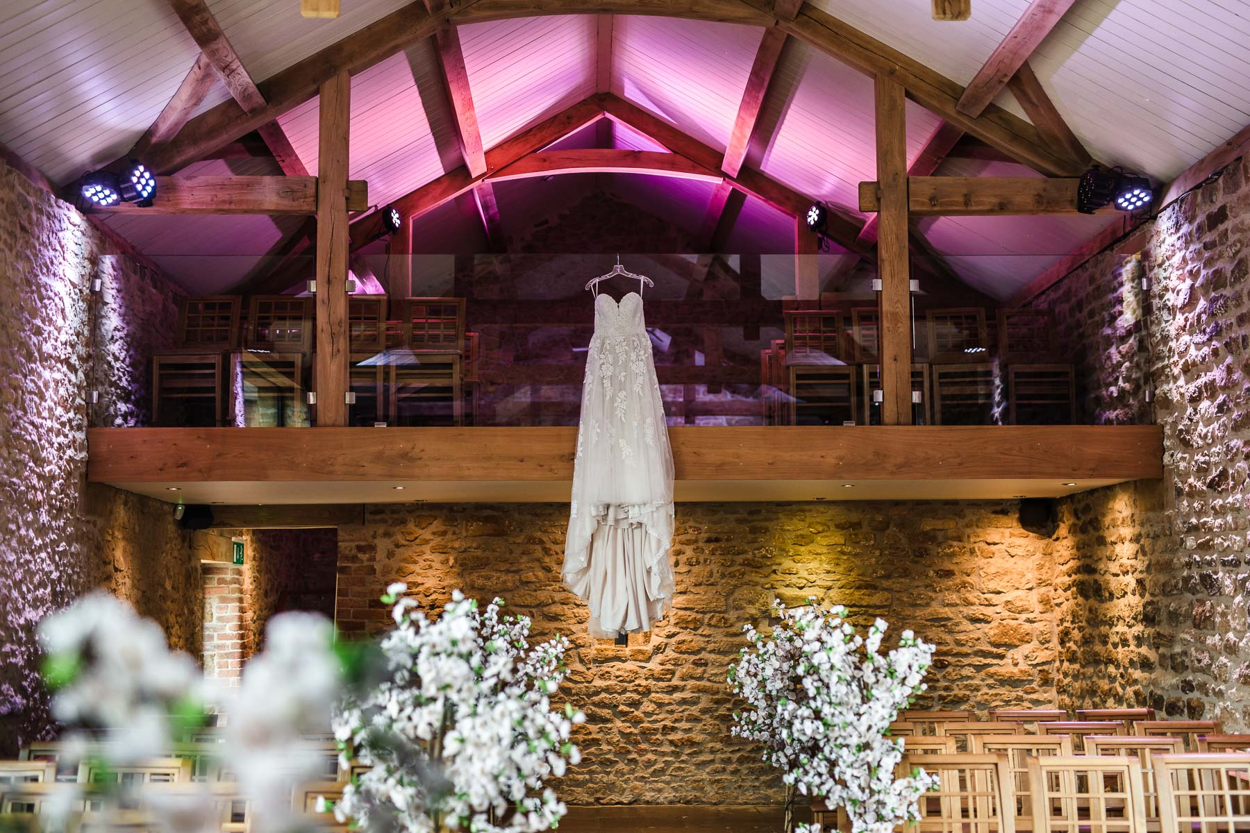 Wedding Dress hanging in the mortain barn