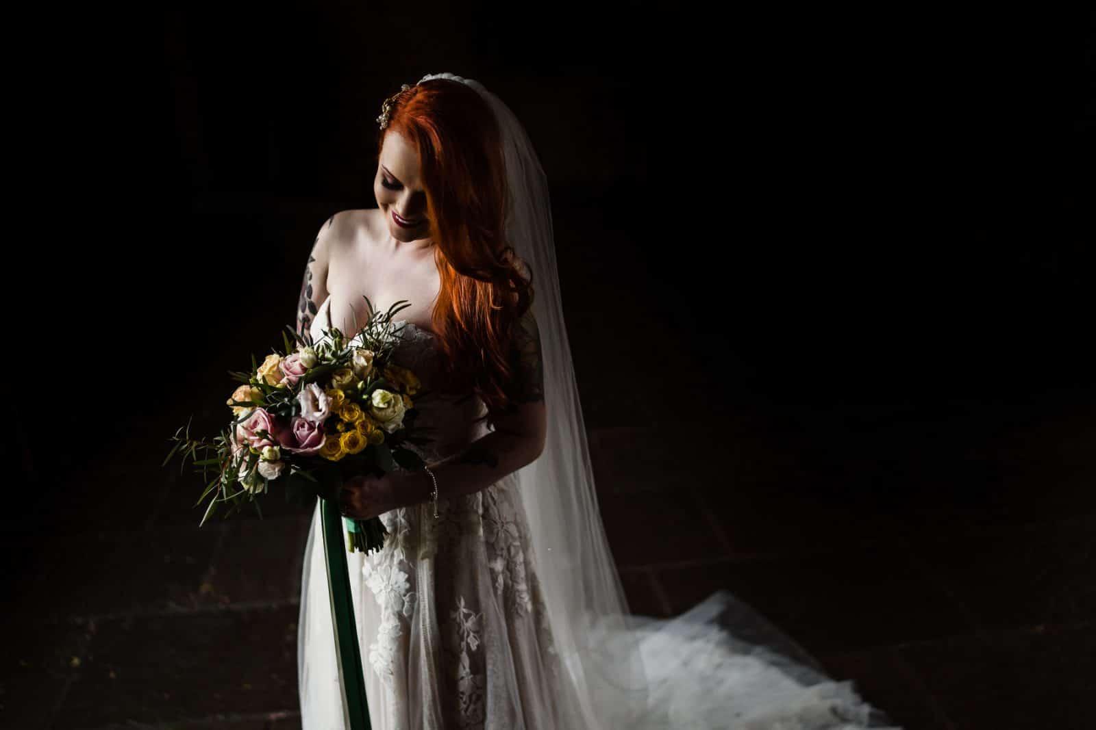 Beautiful bridal portrait of alternative bride with tattoos