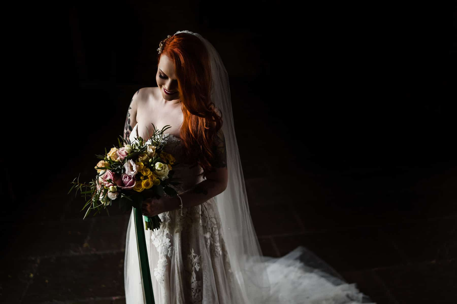Beautiful bridal portrait of alternative bride with tattoos