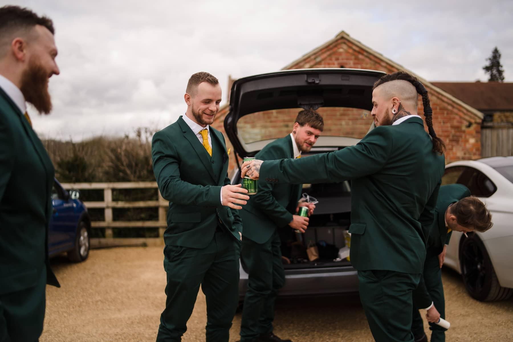 Groom drinking cans of Carlsberg before wedding