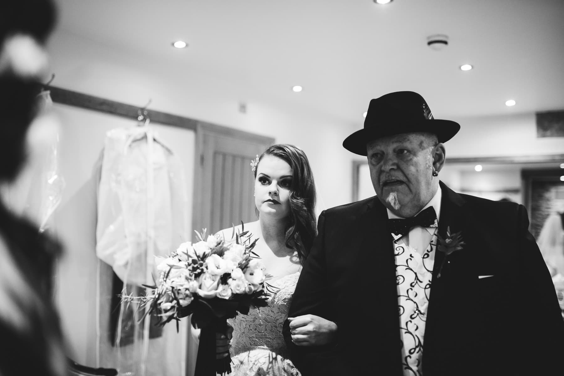 Bride and her father waiting to walk down the aisle alternative Wedding