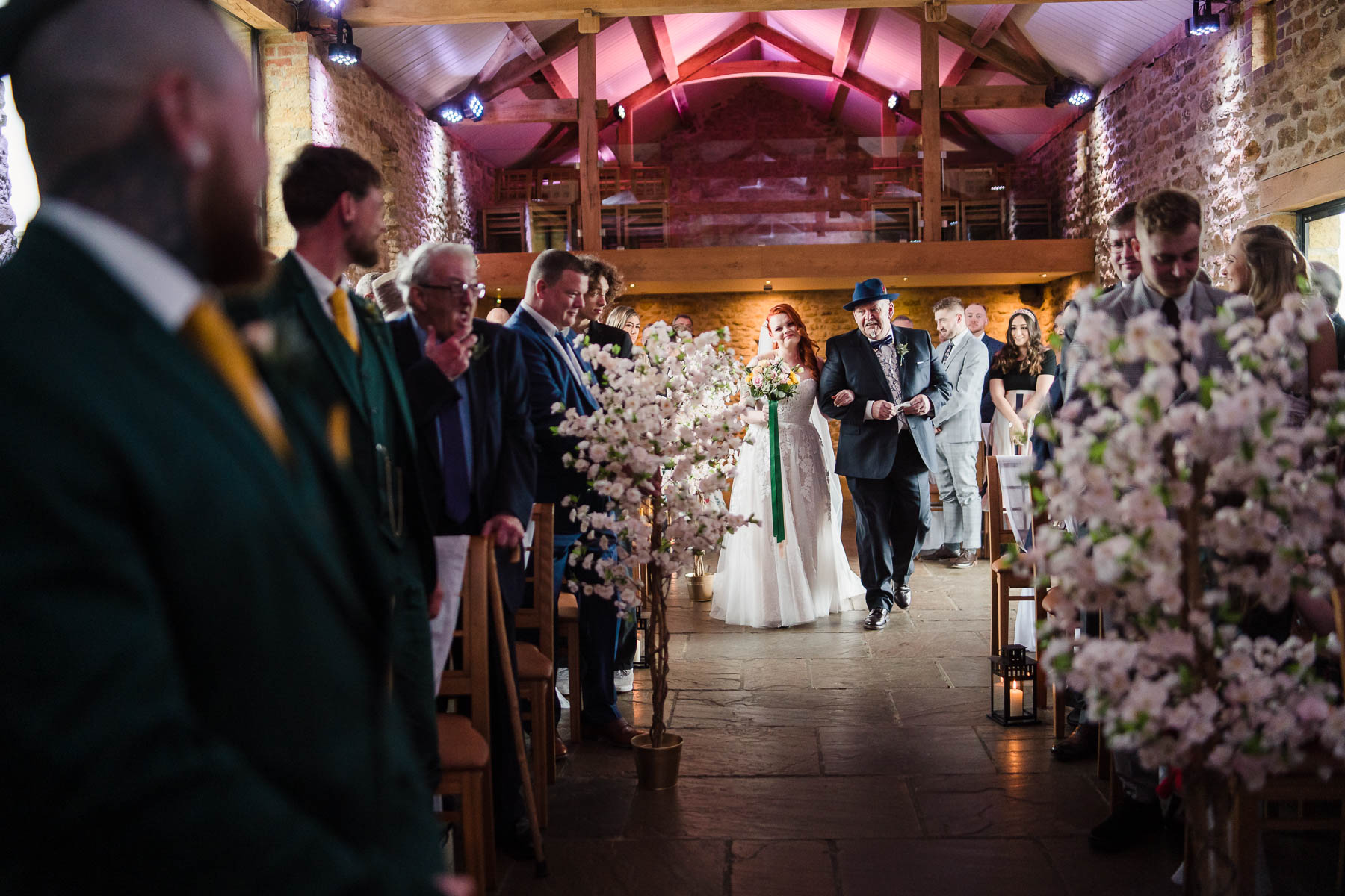 alternative bride walks dow the aisle at dodford manor