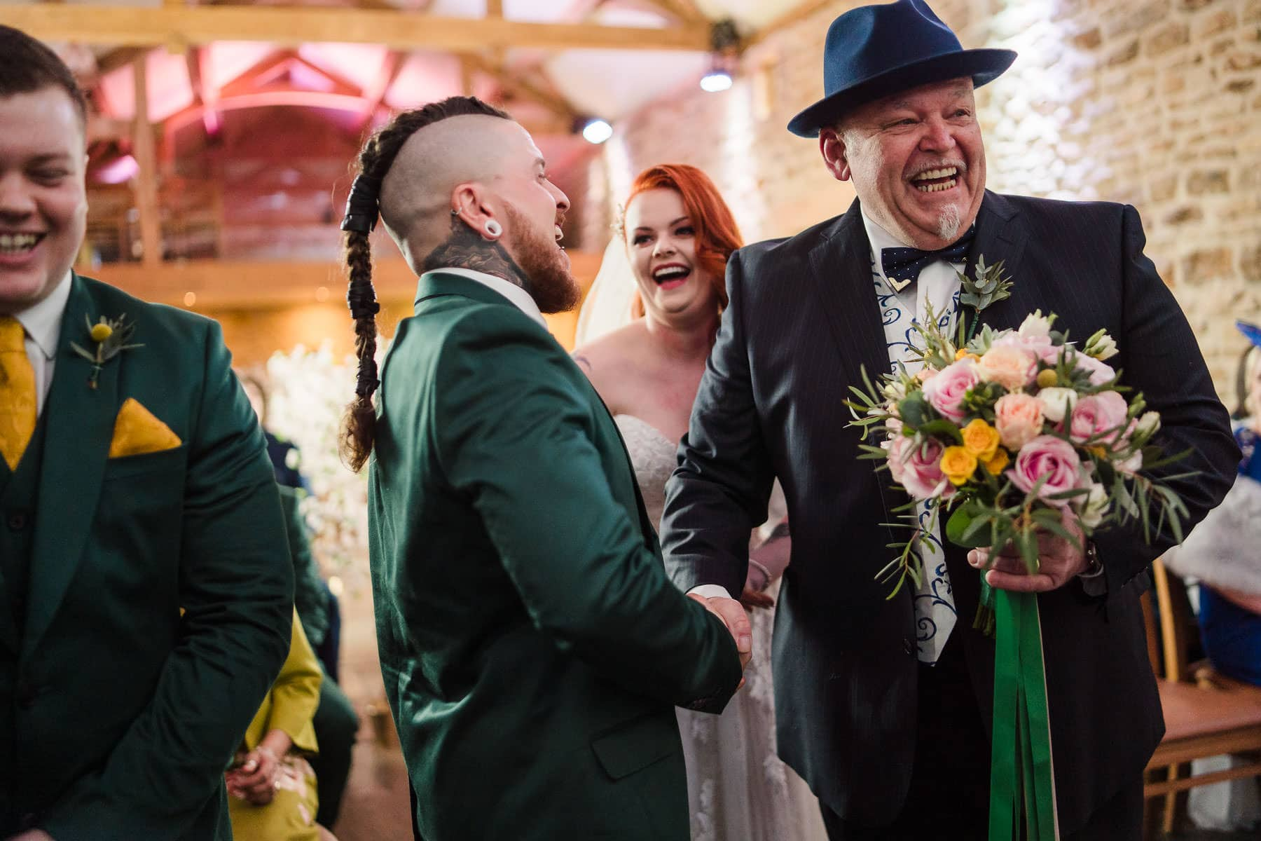 Viking groom shakes hand of father of the bride