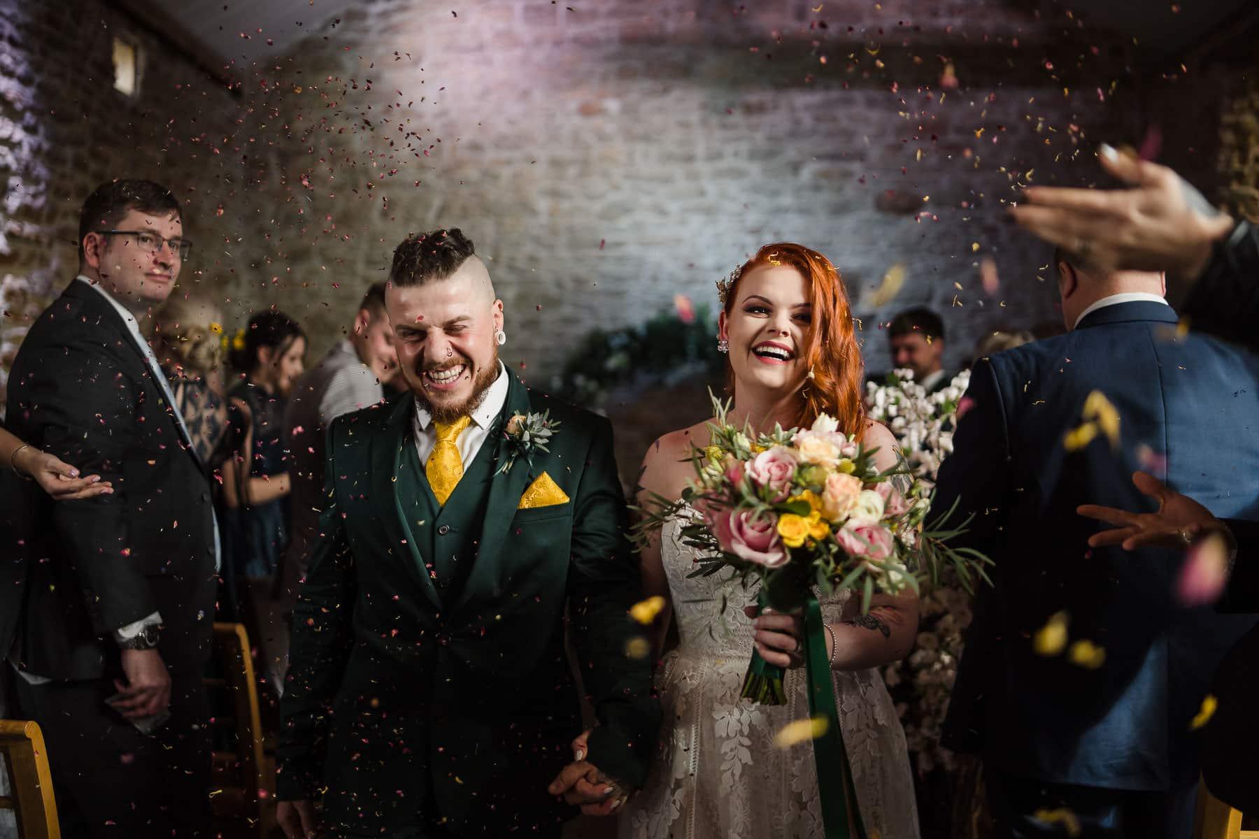 Alternative couple confetti run in the mortain barn