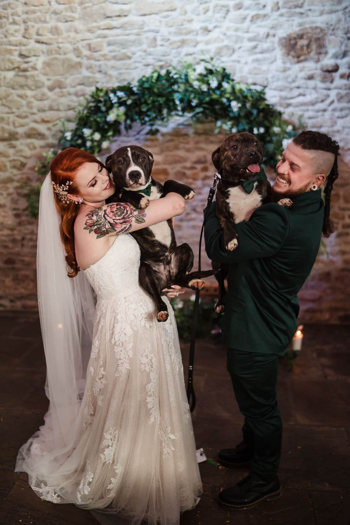 alternative wedding couple with their dogs