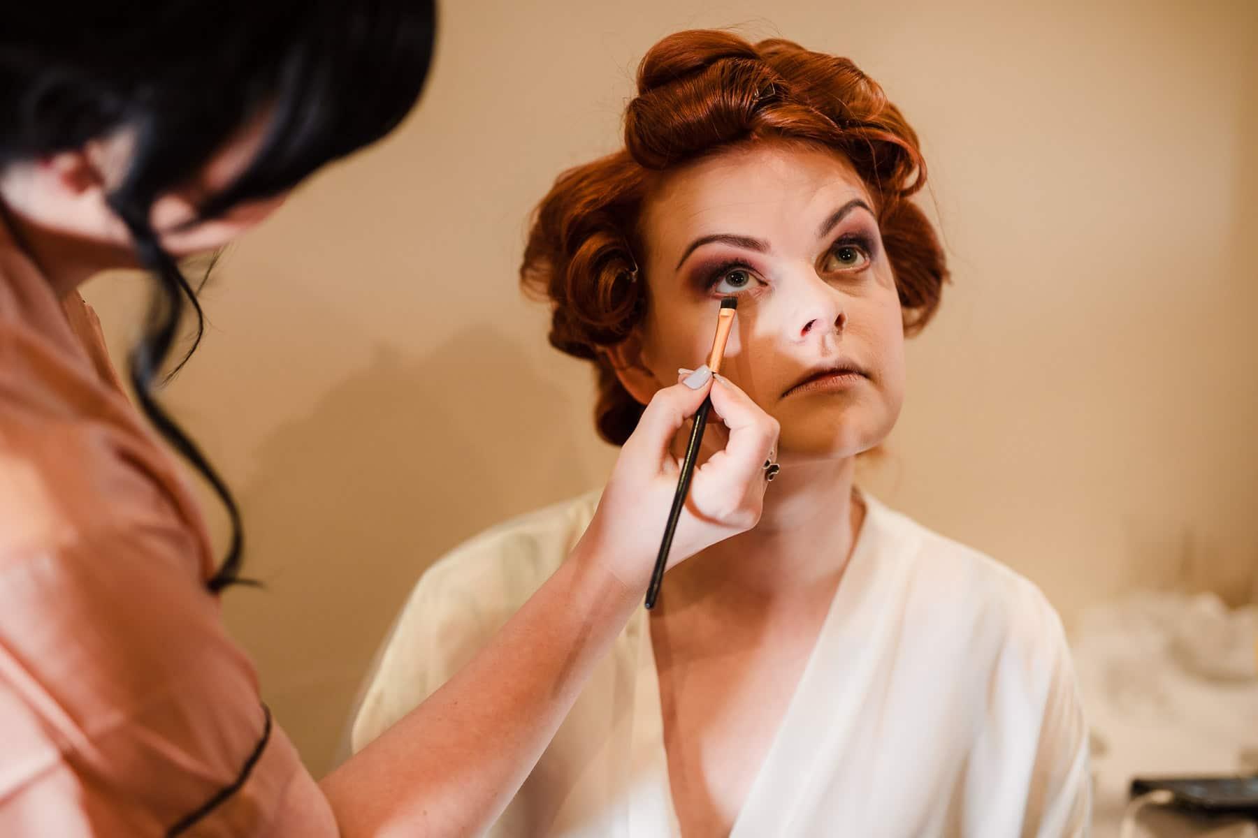 alternative bride having make up applied at Dodford Manor