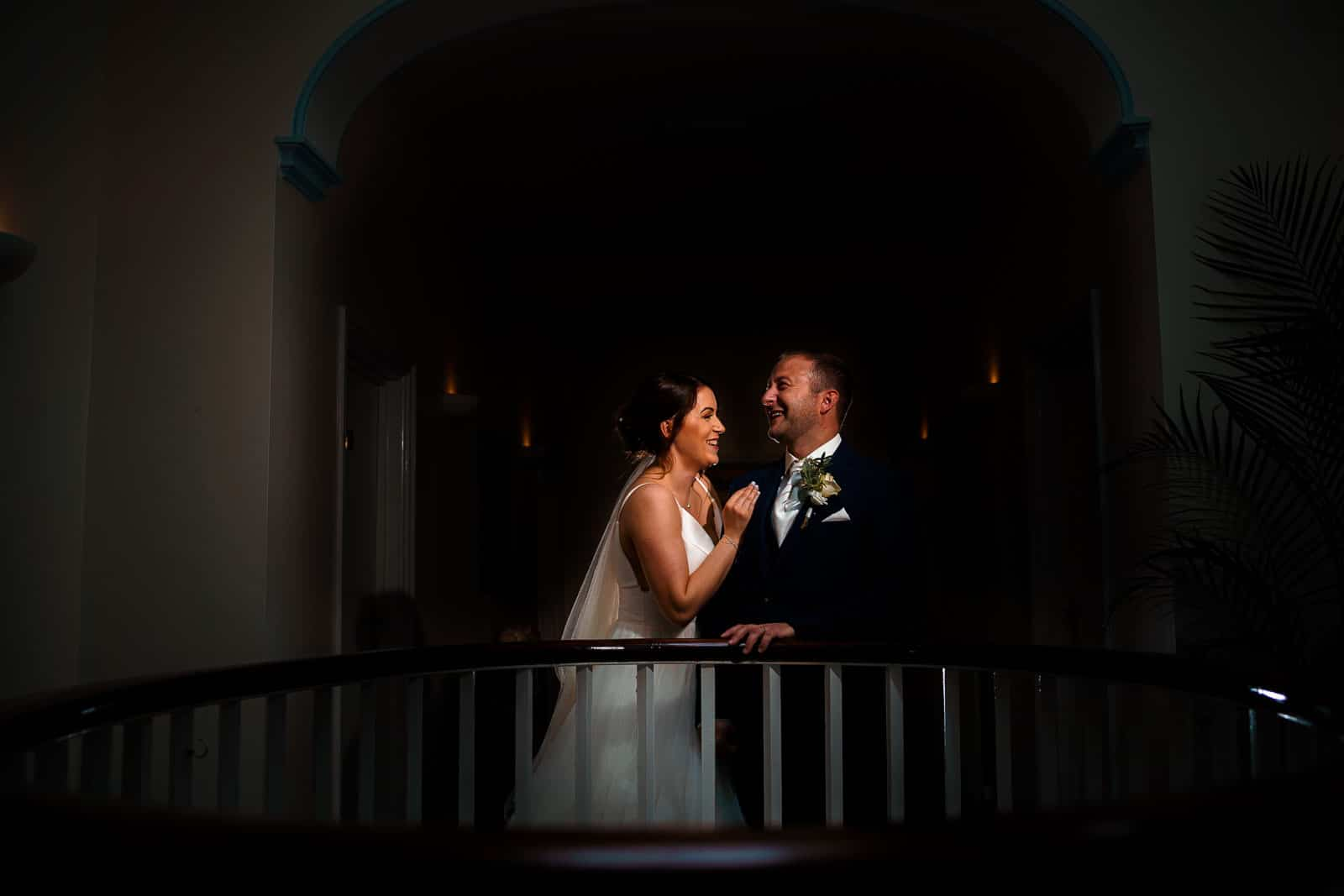 Walnutt inn weding photography in northampton with the couple laughing and the photographer using OCF to illuminate them