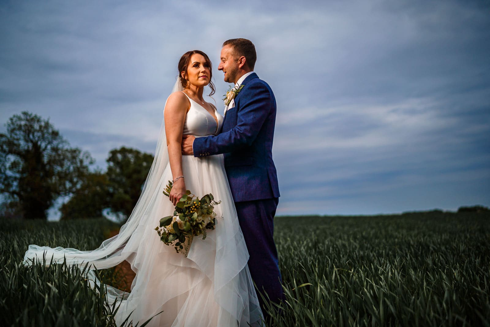 winter wedding photo of a couple in a farmers field