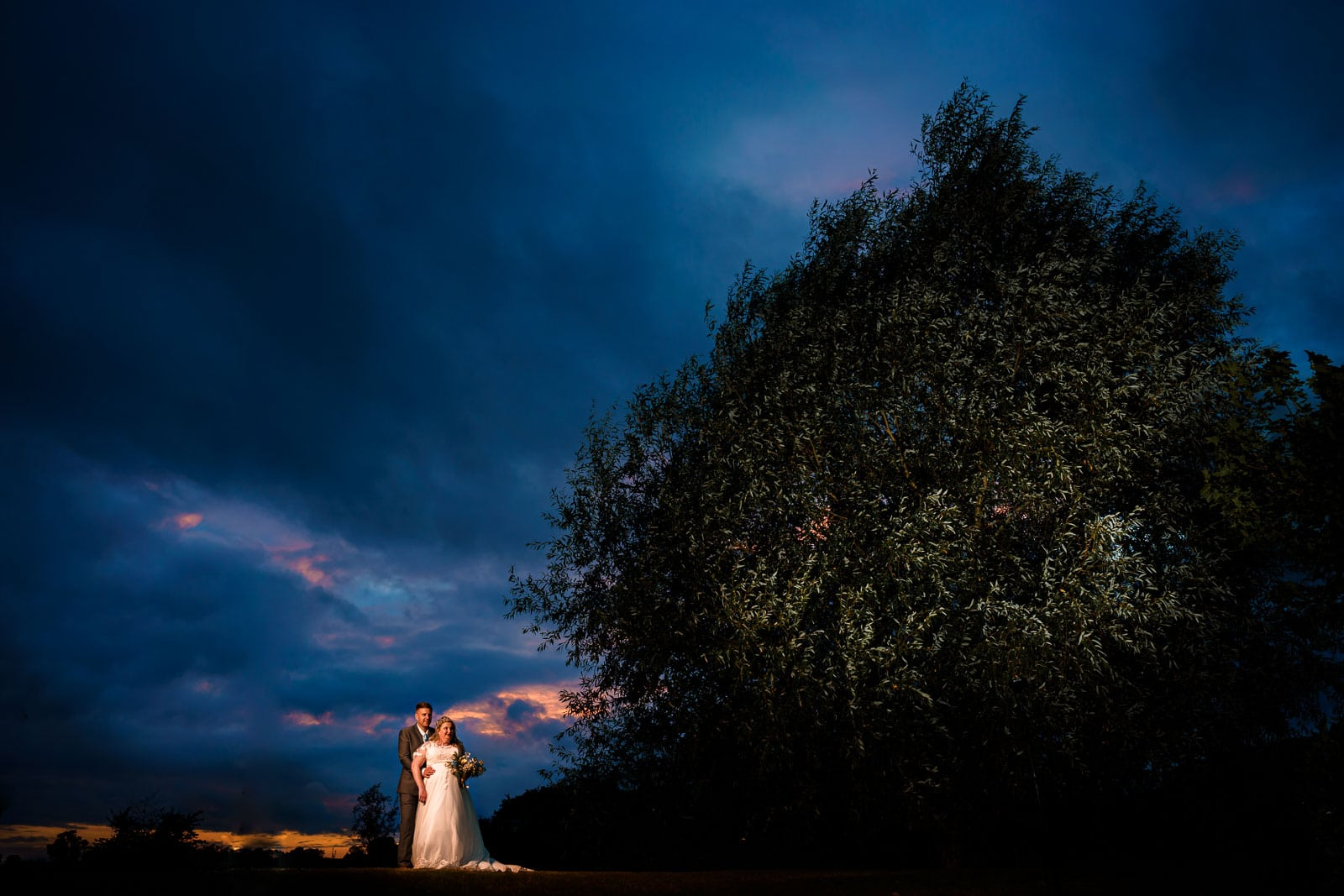 Wootton Park wedding photography using godox lights to illuminate bride and groom