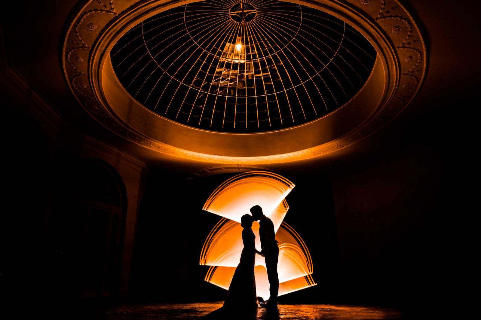 Barton hall orangery at night illuminated with creative lighting and light painting