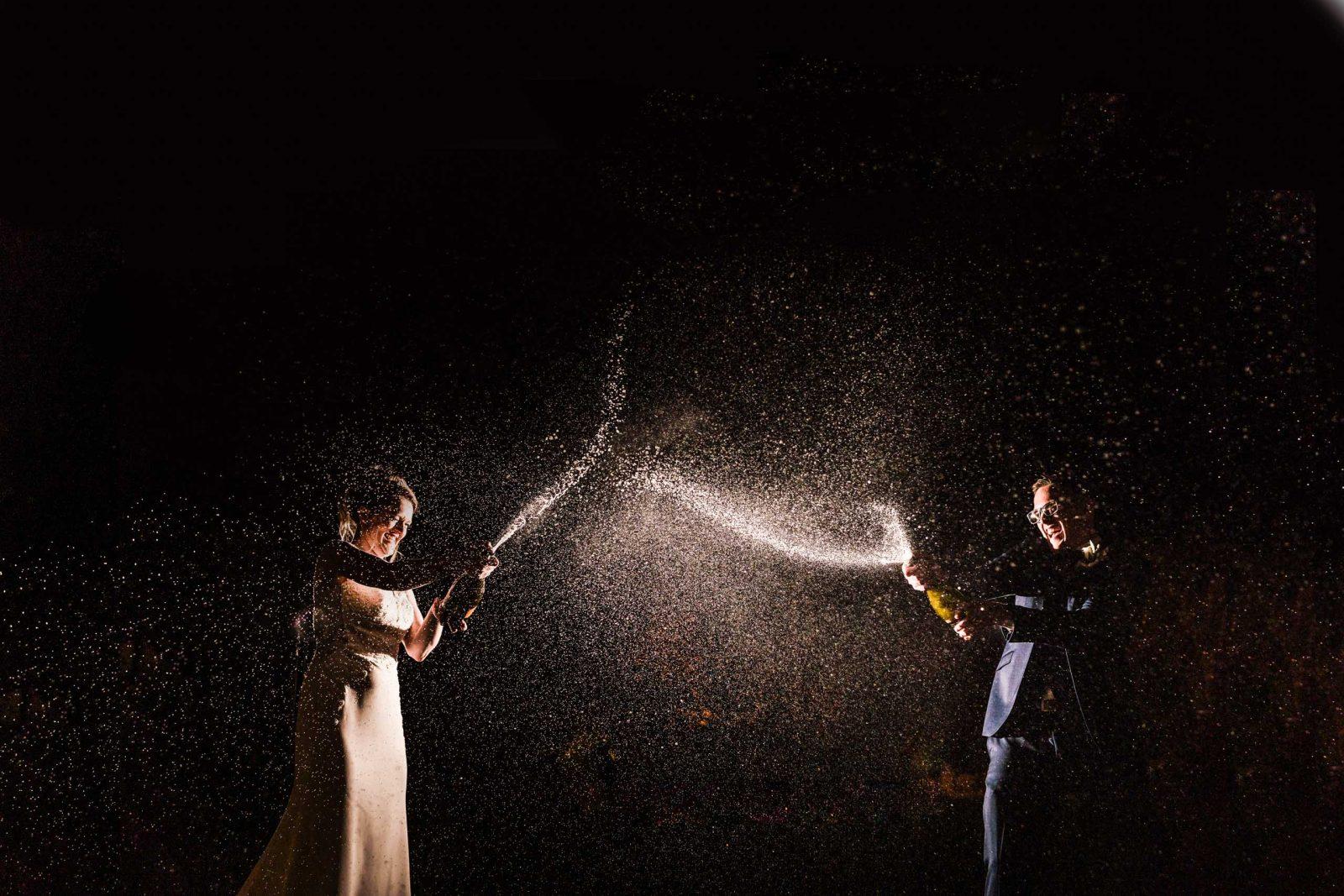 Champagne splash at night with creative lighting