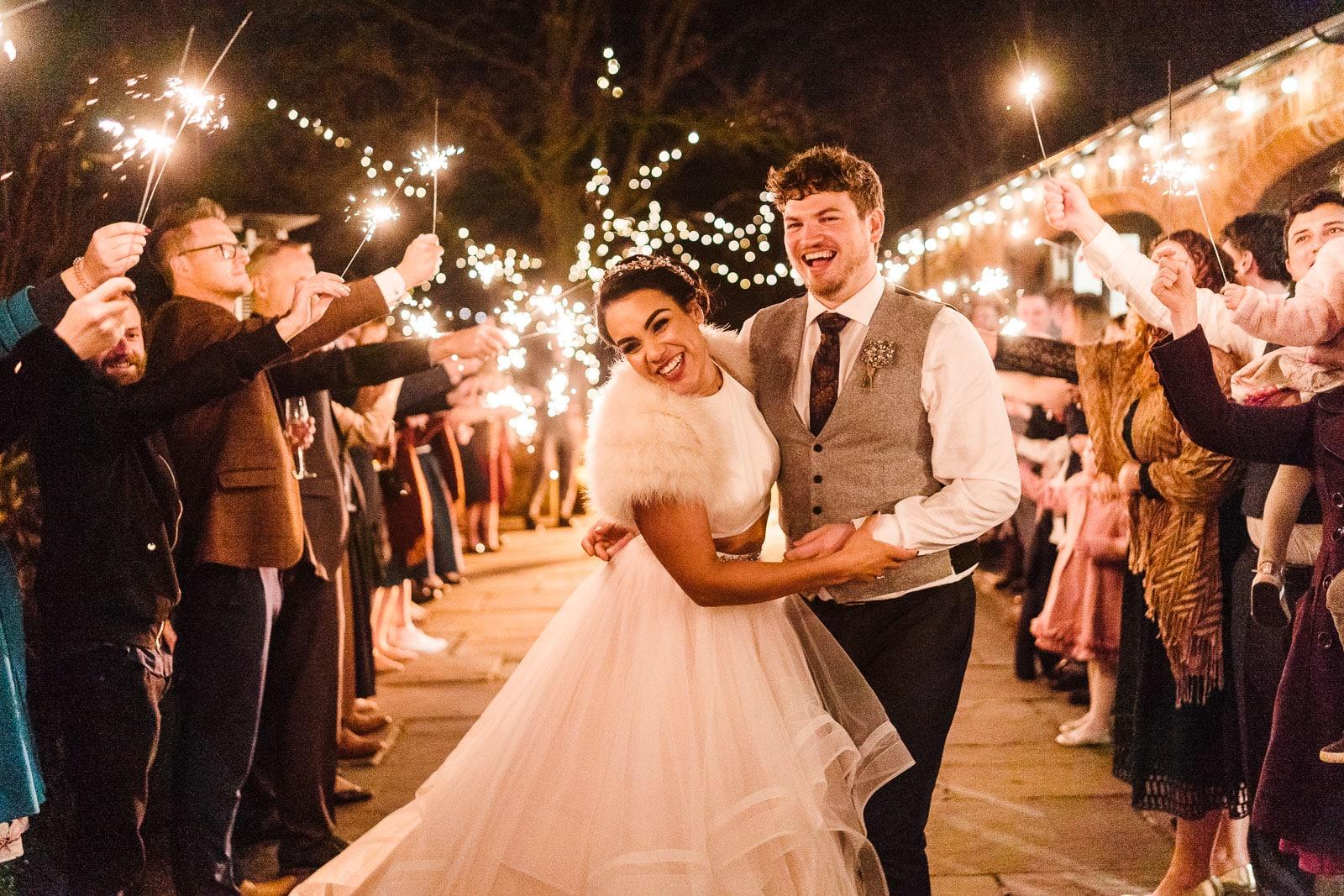 Dodmoor house couple exiting via a sparkler arch