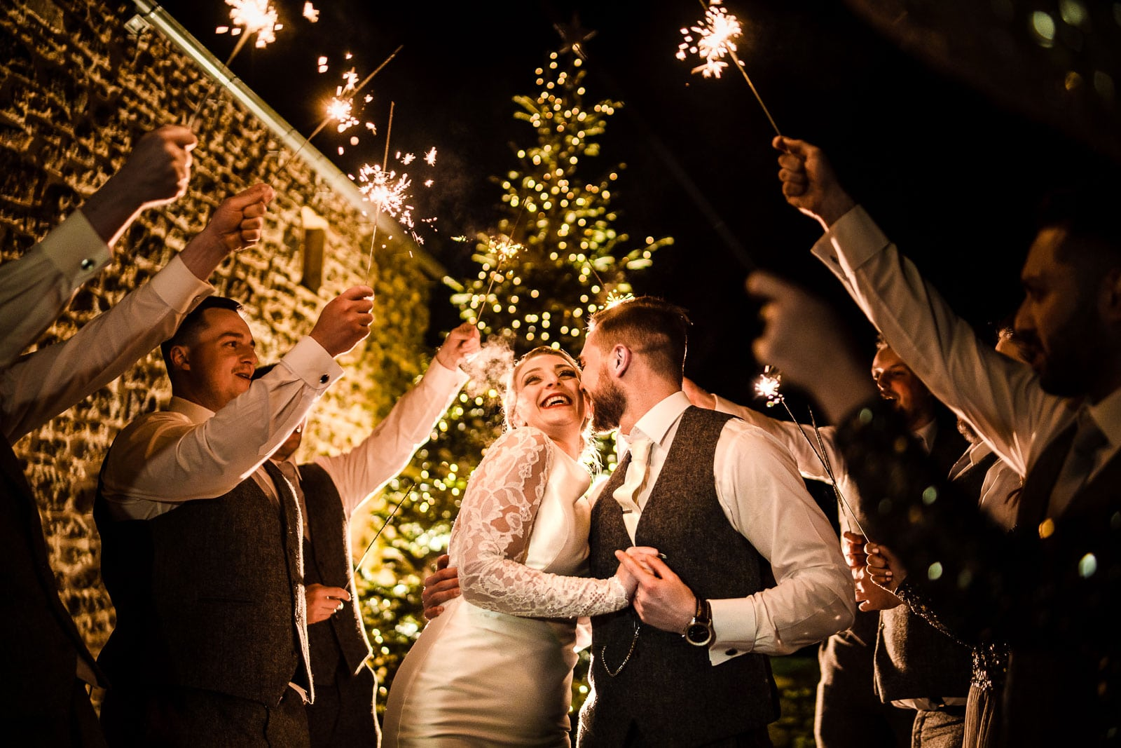 Sparkler exit at dodford manor with christmas tree in the background