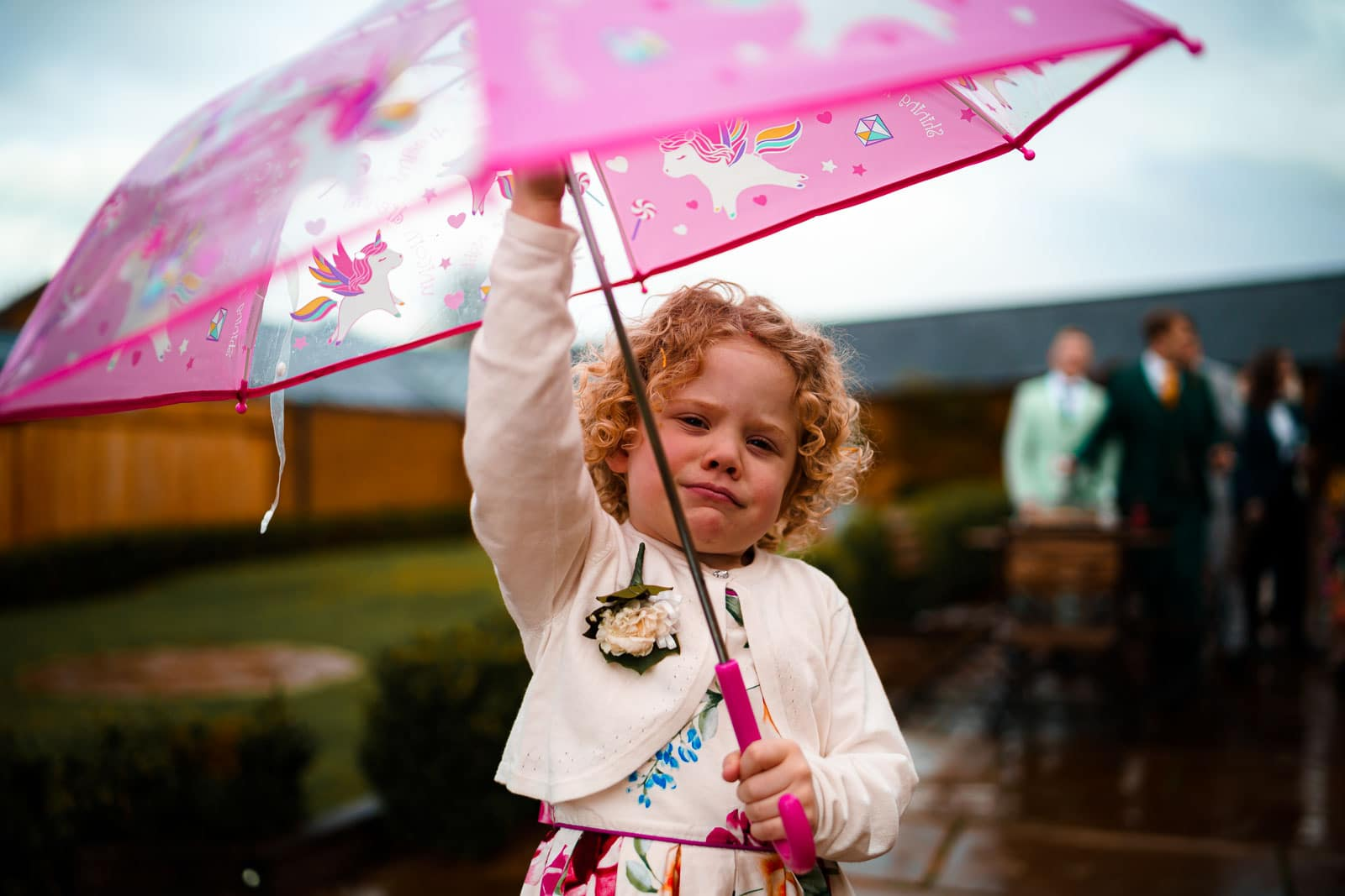 Child holding aloft a umbrella because it